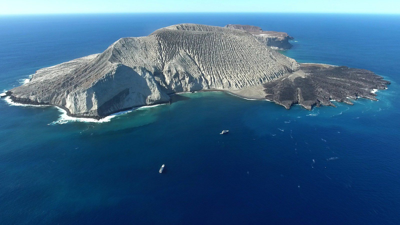 Archipelago Revillagigedo - San Benedicto Island with Bárcena volcano and its lava delta - one click to enlarge - photo from Diving BCS video.