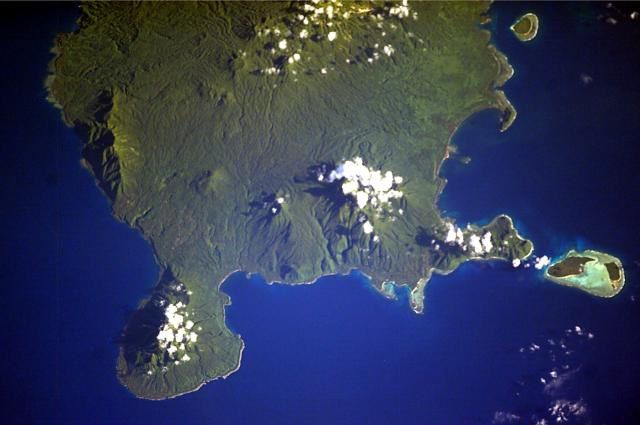 partial view of Vanua Lava taken from the ISS - the active volcano Suretamatai is located under the clouds at the top of the image - NASA Space Shuttle image ISS006-E-40035, 2003