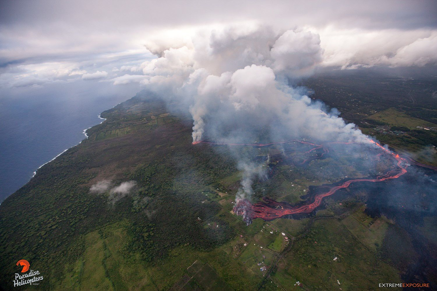 Kilauea East Rift Zone - lava heads to the ocean - photo by Bruce Omori / Paradise Helicopters 18May 2018 / 5:45 am - Kilauea's east rift zone overflight