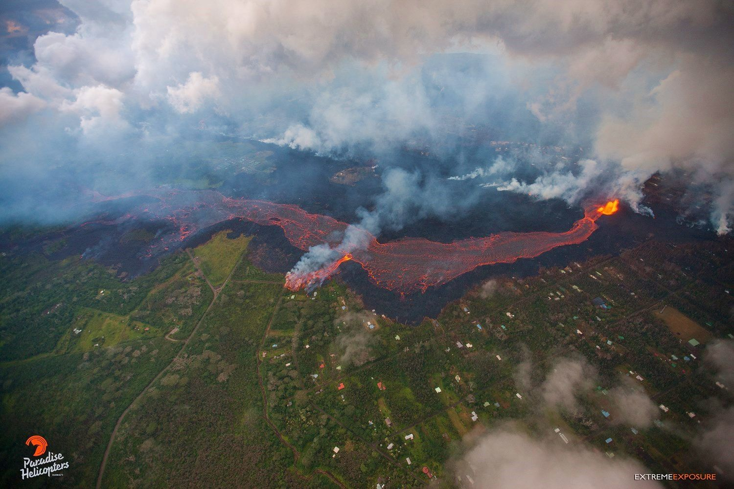 Kilauea East rift zone  - 31.05.2018 - the huge river breached it's deep channel this morning to send another new flow over the banks near the top of Pohoiki Road. - photo Bruce Omori
