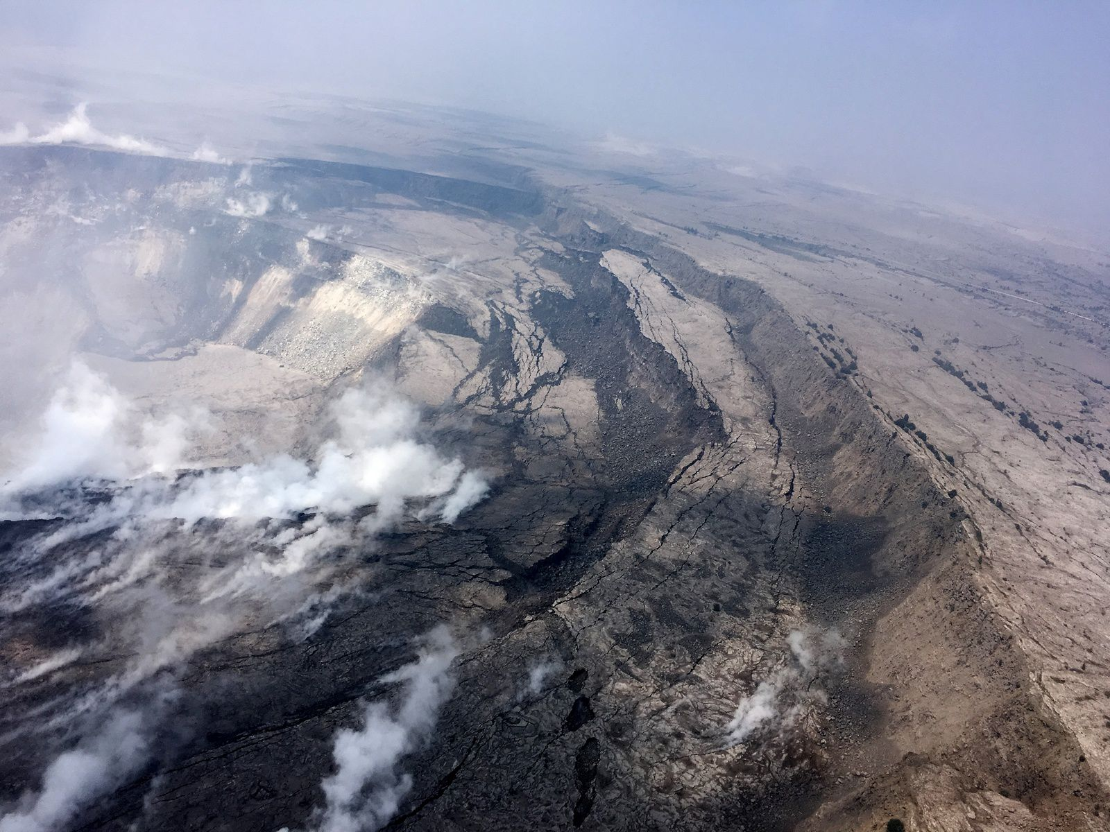 Kilauea summit -  Cracking and slumping of the Halema'uma'u crater walls are clearly evident in this aerial view captured during HVO's overflight of Kīlauea's summit this 09.06.2018