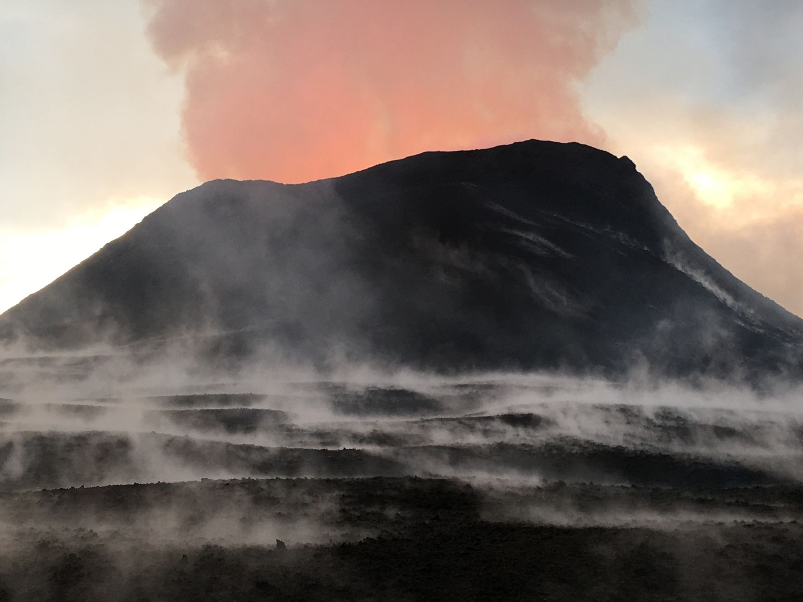Kilauea East rift zone - the spatter cone and tephra is 51 m high at its highest point - The steam in the foreground is the result of heavy morning rain falling on warm (not hot) tephra (lava fragments). - HVO-USGS photo 16.06.2018