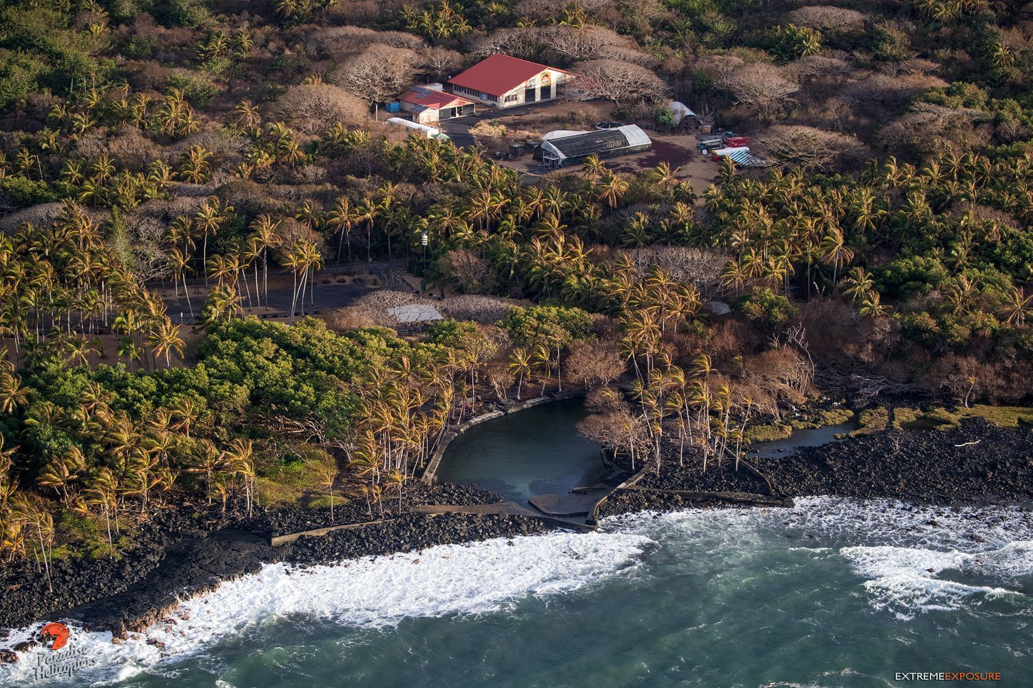 Kilauea's east rift zone overflight - the area under the next threat of lava flows: Ahalanui Beach Park in the foreground and Kua O Ka Lā Charter School in the background - Photo Bruce omori