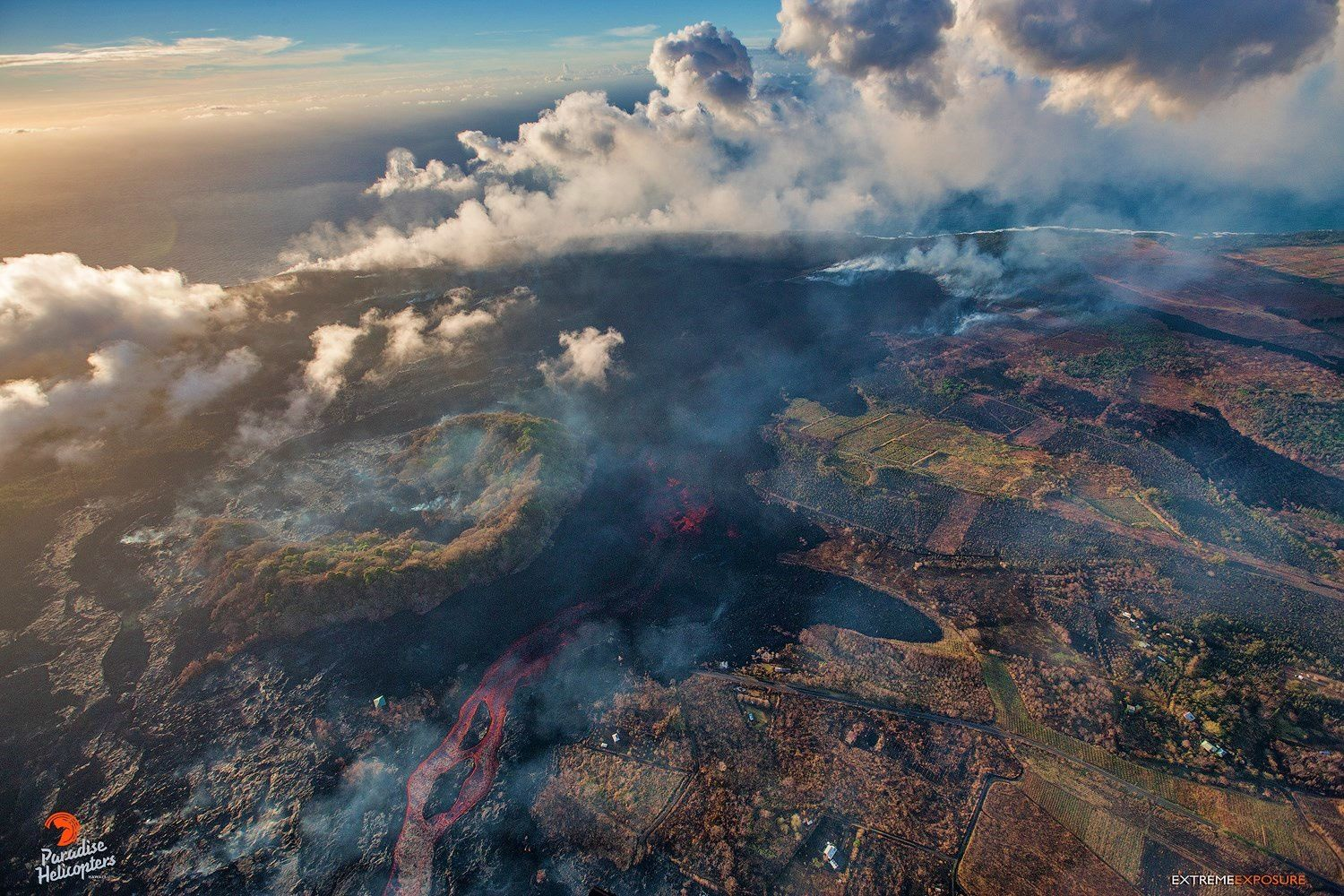 Kilauea East rift area - new path taken by lava flow west of Kapoho crater ( flow from bottom of photo to ocean) - photo Bruce Omori 11.07.2018 / 5:45