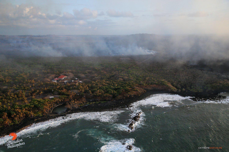 Kilauea East Rift Zone - Ahalanui Beach Park (Warm Ponds) and Kua O Ka Lā Charter School Sites, threatened by A'a flows, no longer existing - Photo Bruce Omori