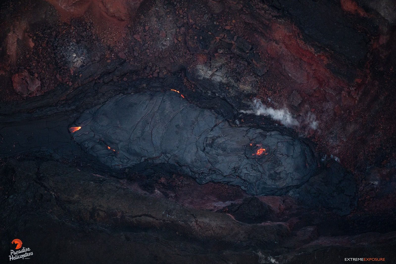 Kilauea East Rift Zone - small lava pond in the cone of crack 8, with hot spots - Stock Photo BO 01.09.2018