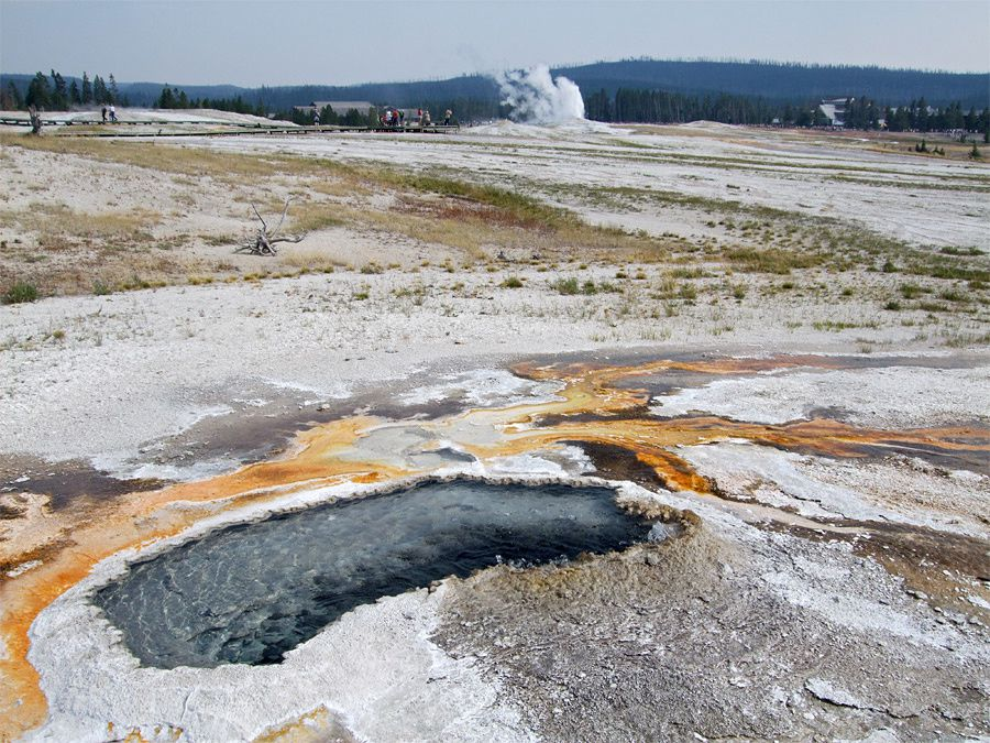 Geyser Hill / Yellowstone N.P. - Ear spring in the foreground, and Old Faithfull in the background - Yellowstone National Park photo
