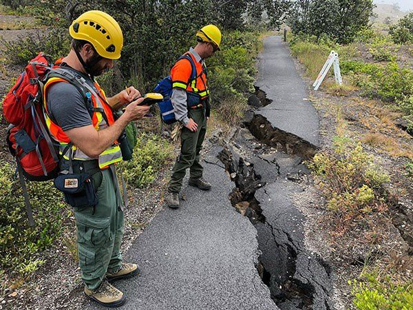 Hawai'i Volcanoes National Park - National Park Service geomorphologist Eric Bilderback records earthquake damage and assesses stability along Crater Rim trail - NPS photo
