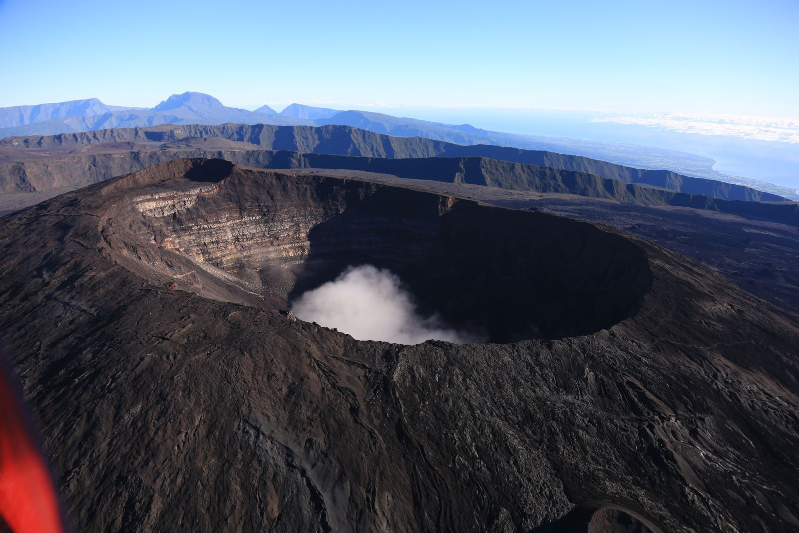 Piton de La Fournaise - the crater Dolomieu, with in the background, the ramparts of Enclos Fouqué and the Piton des Neiges - photo archive © Bernard Duyck