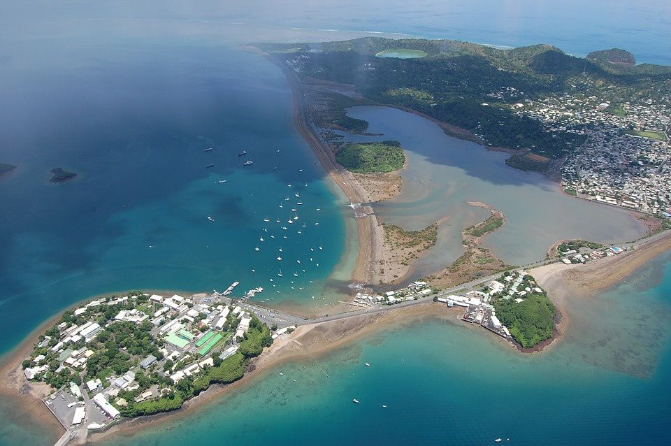 "Mayotte - The ""rock"" of Dzaoudzi, the Boulevard des Crabes, the Badamiers mudflats and part of Petite-Terre, seen from the plane. - photo Yane Mainard"