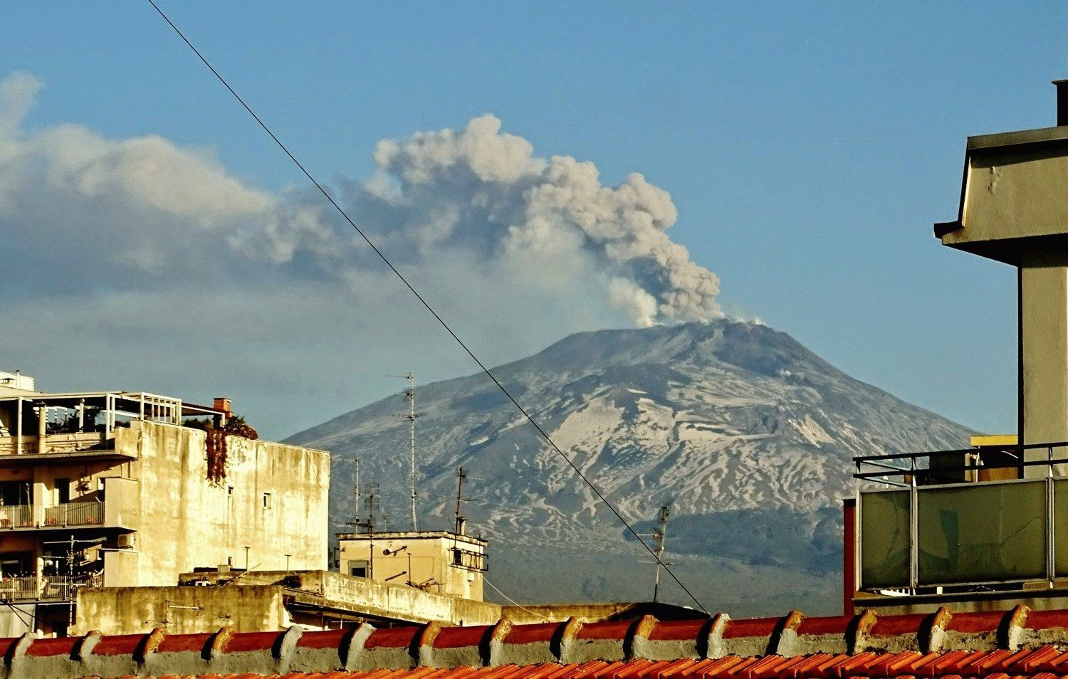 Etna - the ash plume of the NEC seen from the roof of the Etna-Observatory in Catania this morning, February 18, 2019. The wind was pushing it westward, an unusual direction. - photo Boris Behncke