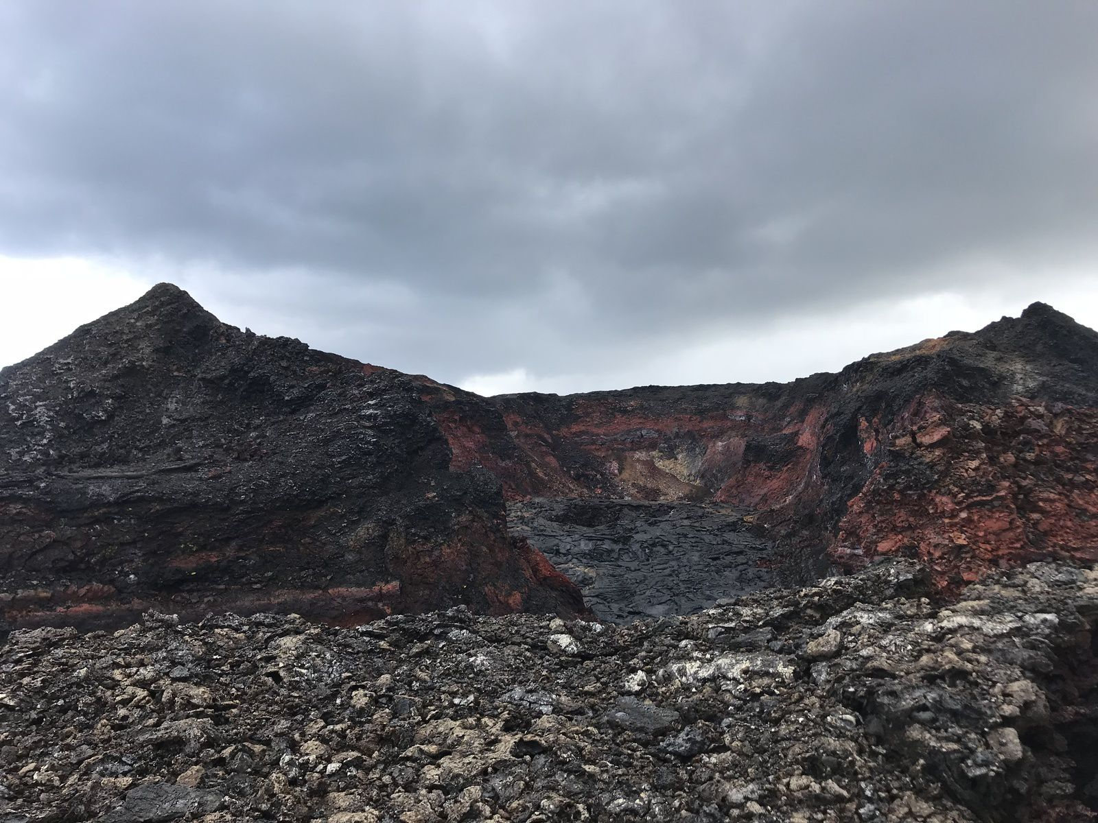 Kilauea - On June 3rd, an HVO field geologist went to the site of Webcam Fissure8 in the Lower East Rift Zone of Kīlauea Volcano, to change the batteries of the webcam and visually observe the cone and the inside of the fissure8. No steam or fumes were visible and only a slight smell of sulfur was detected momentarily. - USGS image by C. Parcheta.