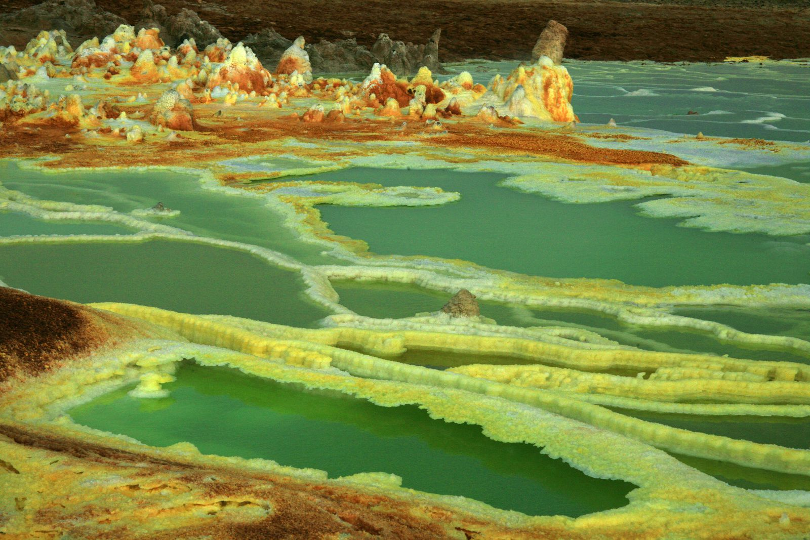 Dallol and its basins with acidic waters hemmed with salt and sulfur - photo © Bernard Duyck 2007