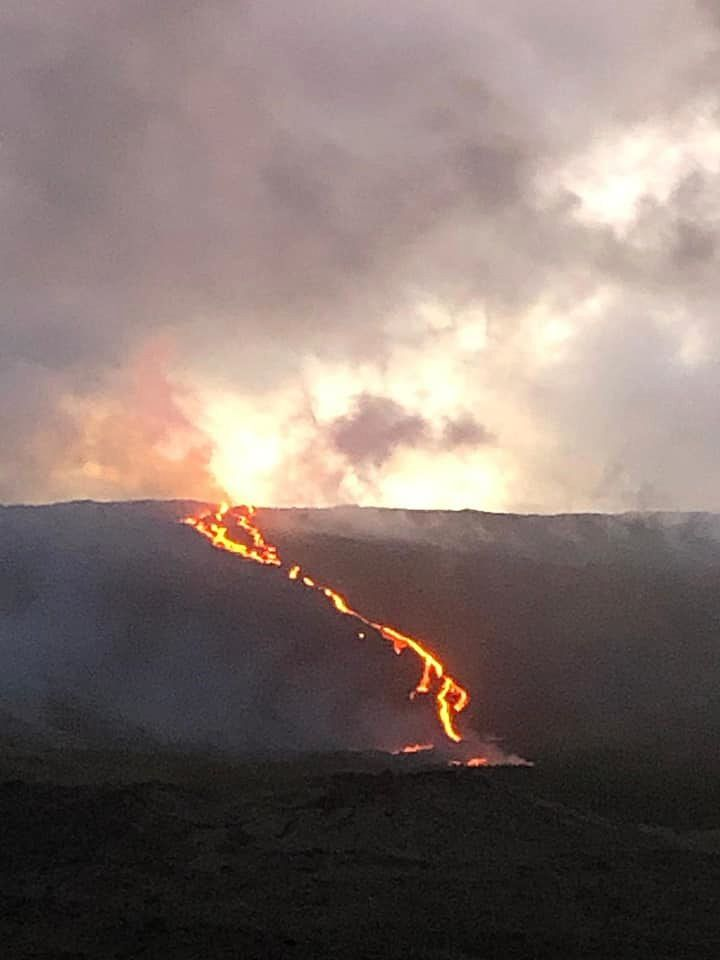 Piton de La Fournaise - a gap in the clouds can see the lava flow towards the RN2 12.08.2019 in the evening - photo OVPF