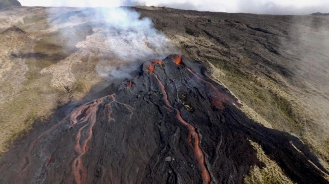 "Piton de La Fournaise - The Piton, with his 2 eruptive mouths, of the eruption from 11 to 15.08.2019, named ""Piton Louise and Henri Cornu"" - photo Imazpress"
