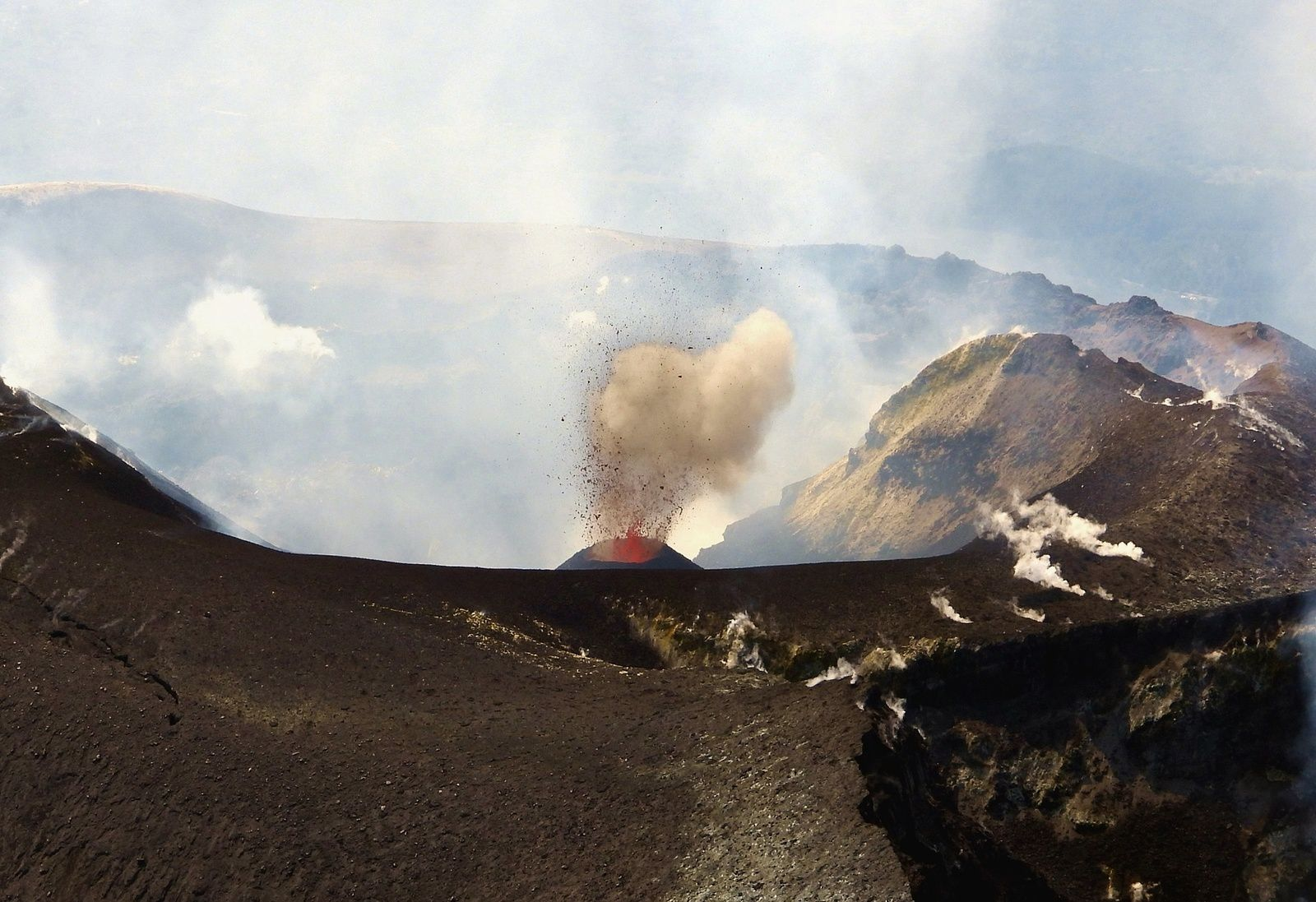 Etna - The new scoria cone in the Voragine crater, seen by helicopter on the afternoon of September 15, 2019. In the foreground, on the right, we can see part of the Northeast crater; in the background, the ridge of the southern edge of the crater of Bocca Nuova. - photo Boris Behncke / via INGVvulcani