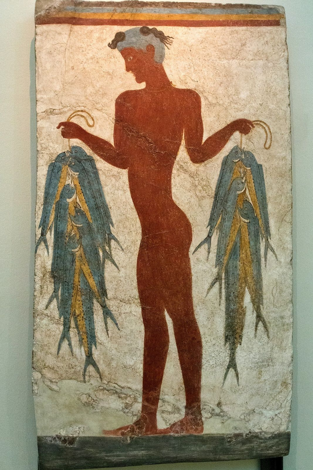 Santorini - archaeological site of Akrotiri - West house / room 4 - decoration with a young man with fish, naked and shaved head - photo © Bernard Duyck 09.2019