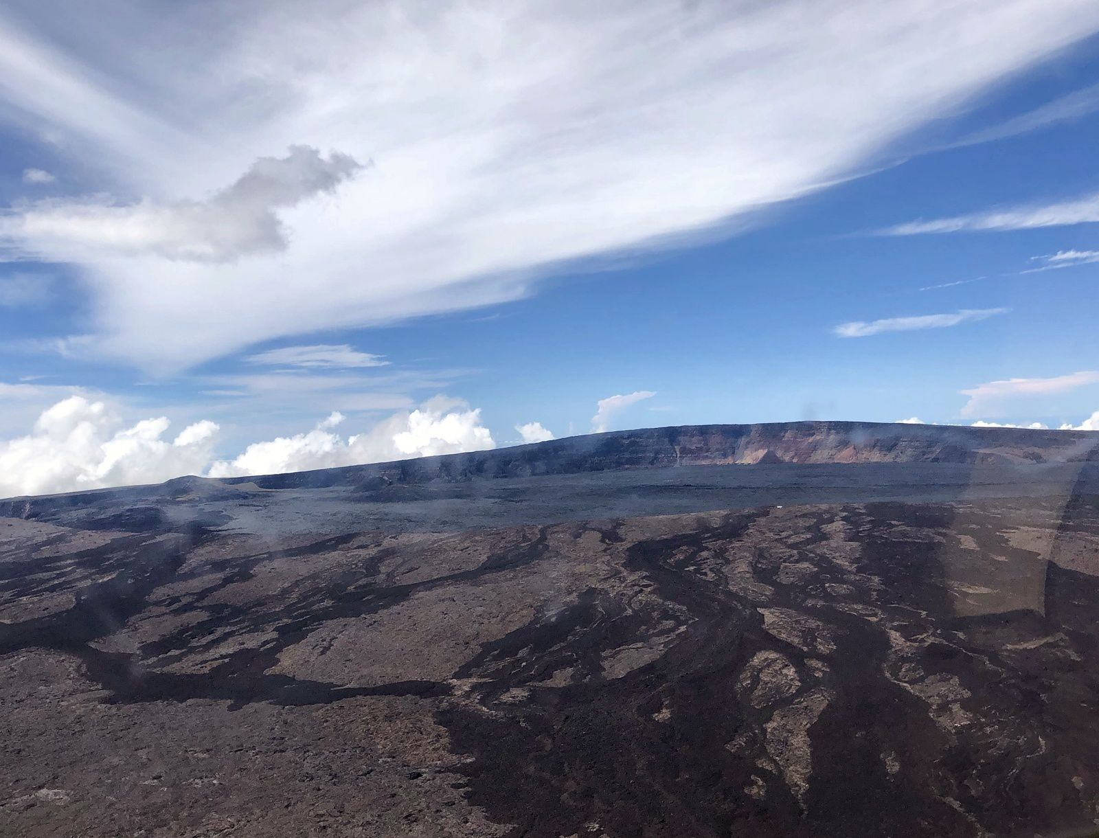 Mauna Loa - The true summit of the volcano-bouckier is located just to the right of the center of the photo. The cones formed during the eruptions of 1940 (right) and 1949 (left) are visible in the background on the left. - Civil Air Patrol photo of October 20, 2019