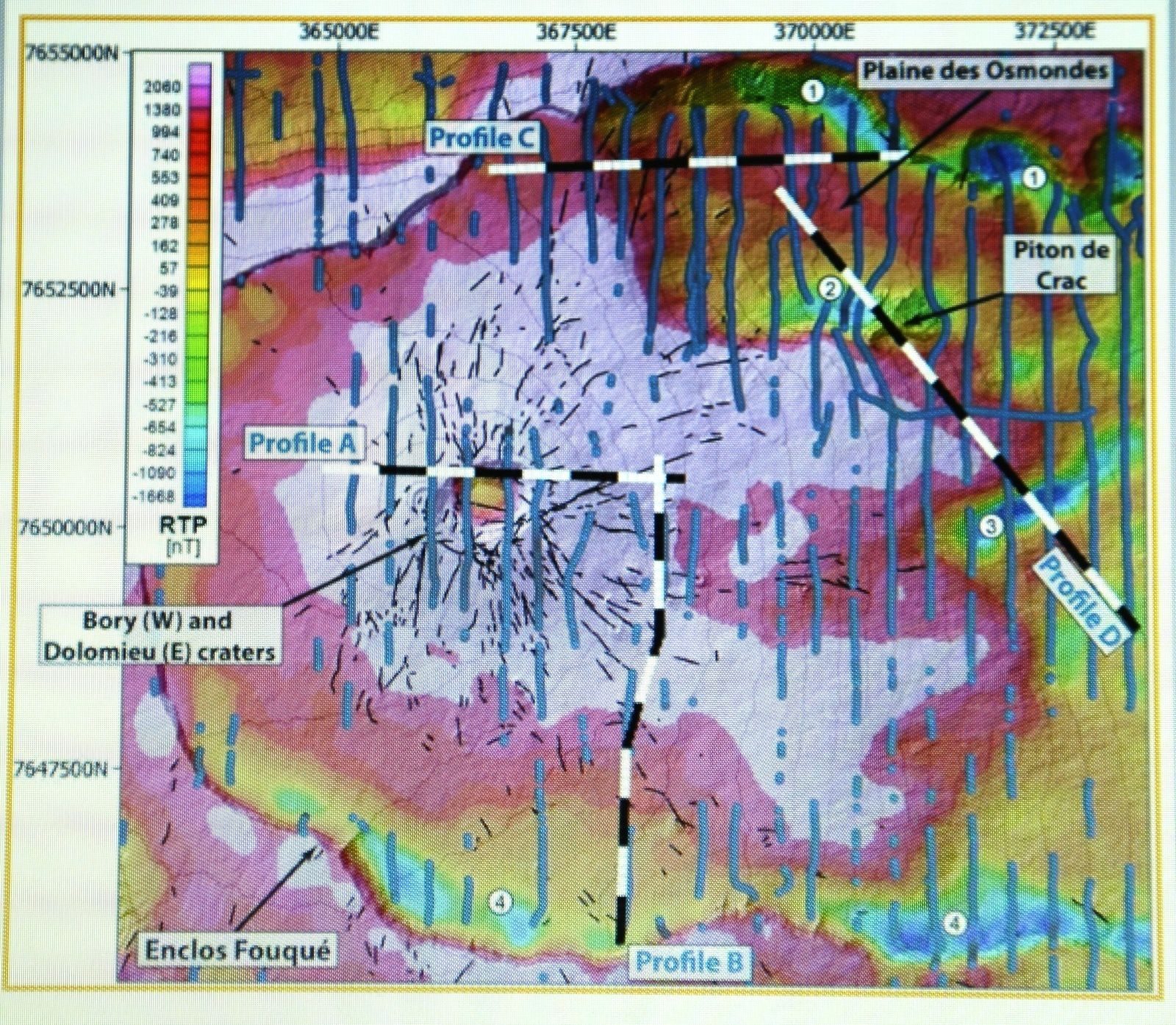 Location of the 3.655 inverted AEM soundings (blue dots) above the active part of the Piton de la Fournaise volcano (i.e. the Enclos Fouqué caldera), displayed on the magnetic anomaly map (reduced to the pole to lined-up anomalies with magnetic sources). The eruptive fissures visible in the field are denoted in black. The number refers to the negative magnetic anomalies discussed in the text. The 2D profiles (A–D) are marked with white/black lines (the color of the line changes each 500 m). The map has been created using open source QGIS 3.8.3. Coordinates in meters (WGS84, UTM 40S).  - image extracted from doc. referenced in source