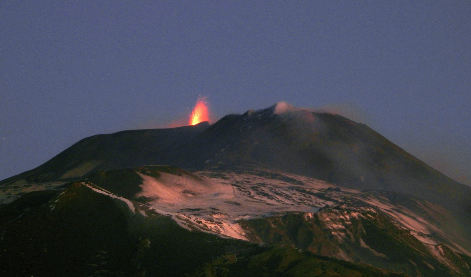 Etna - Strombolian explosions on its Voragine crater (one of the four summit craters of the volcano). Photo taken at dawn on January 30, 2020 (view from the south) by Boris Behncke