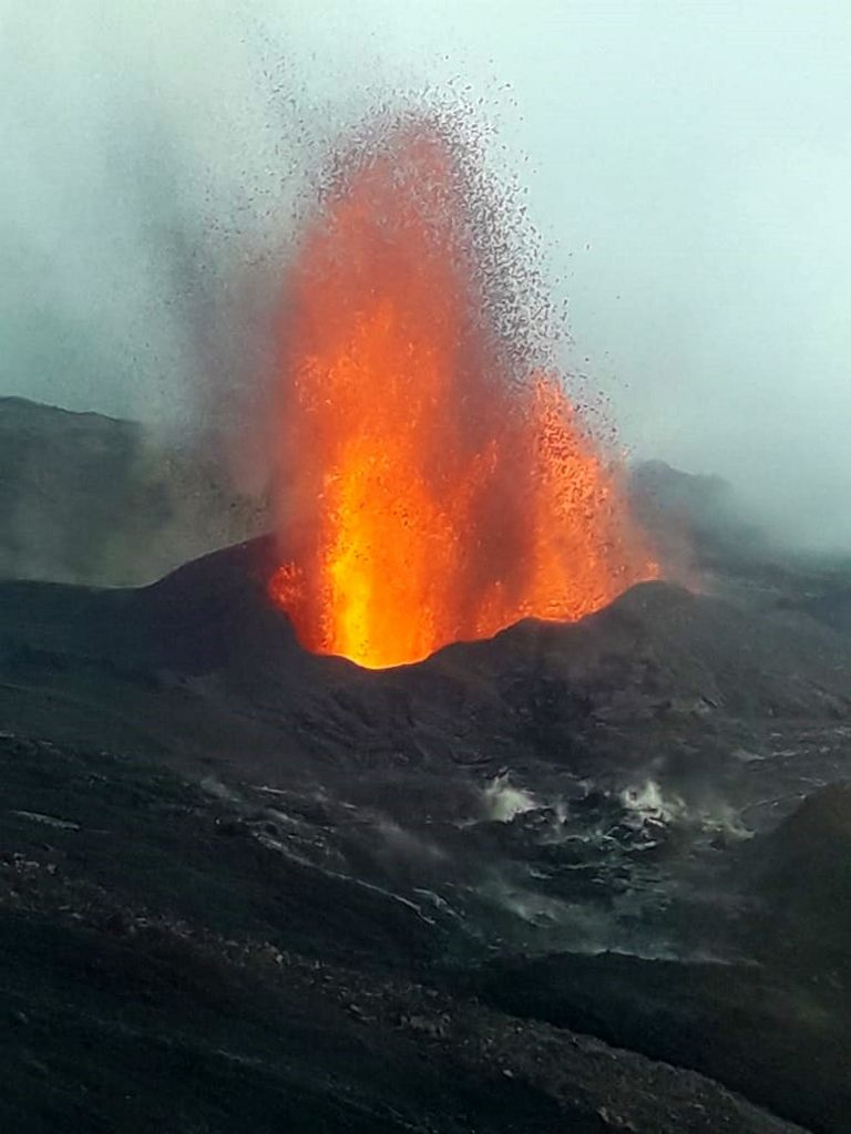 Piton de La Fournaise - overflight of the eruptive site by the PGHM on 05.04.2020: lava fountain 50 m high. and rapid construction of a cone - photo SAG and PGHM via OVPF