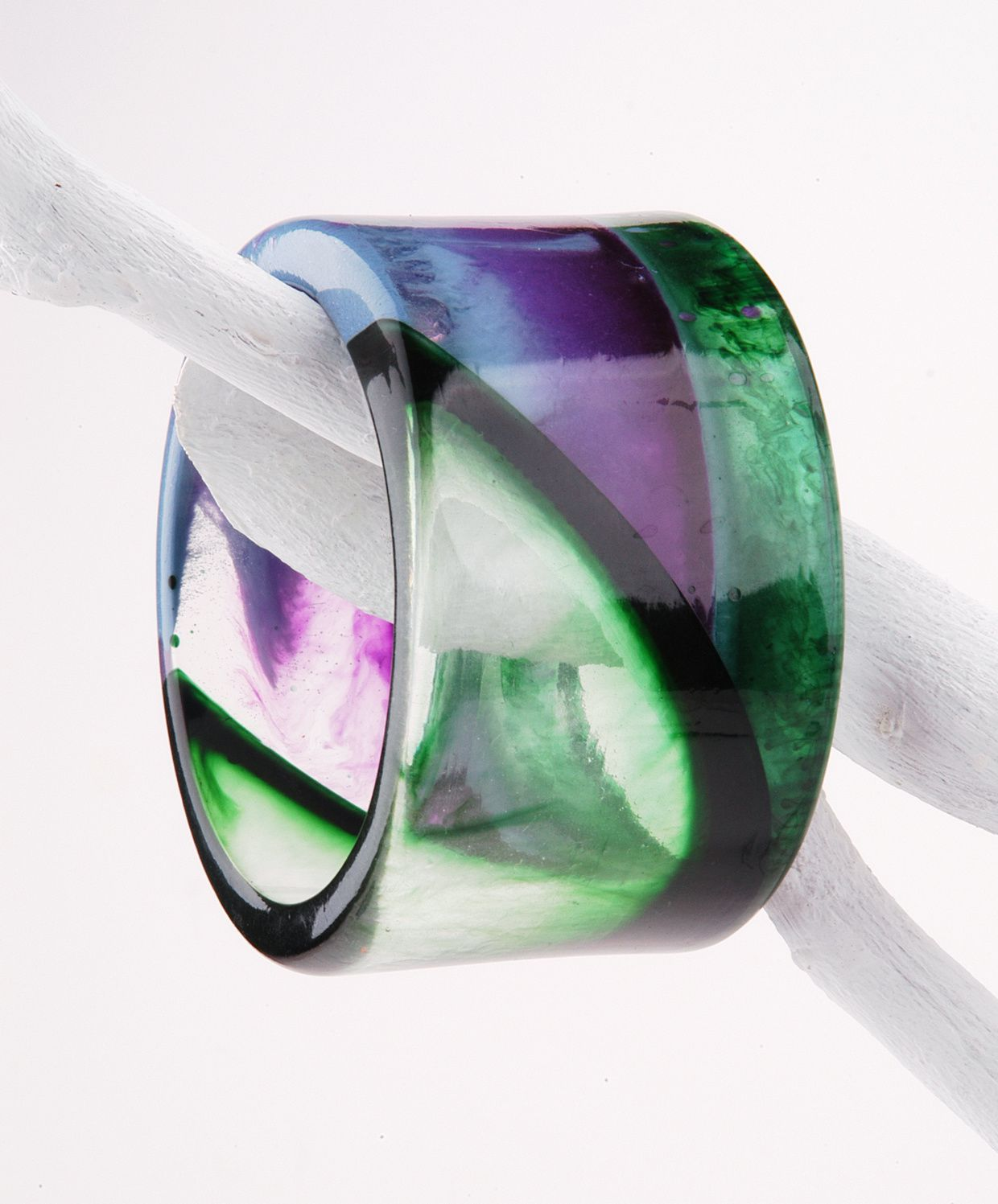 Transparent and opaque parts alternate in the first version of hand made resin bangle
