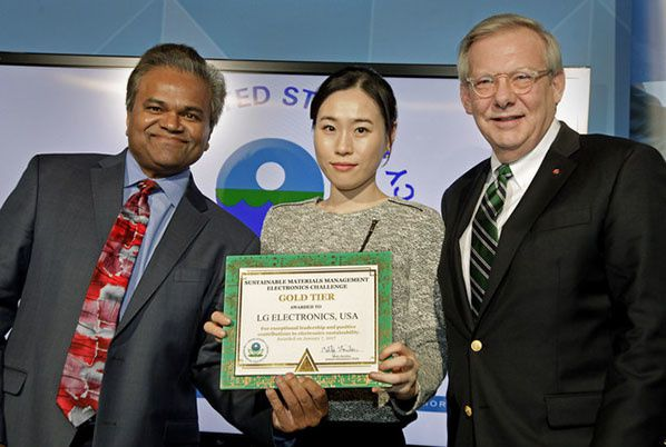 Obama Administration official Mathy Stanislaus, Assistant Administrator for EPA's Office of Land and Emergency Management, Jane Kang, Head of Product Stewardship, LG U.S., John Taylor, Vice President of Public Affairs, LG U.S., Receiving EPA