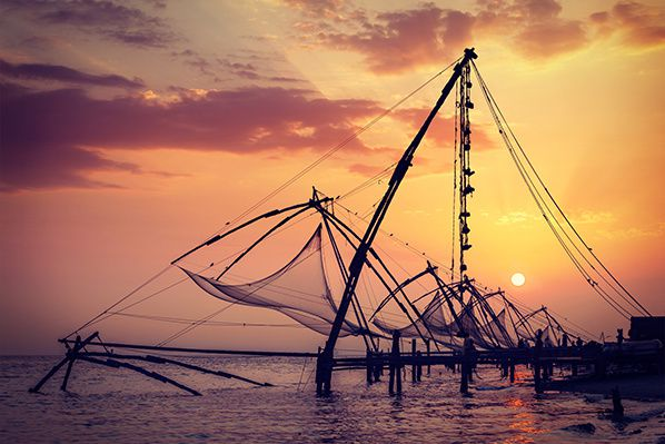 Chinese fishnets on sunset. Kochi, Kerala, India © f9photos