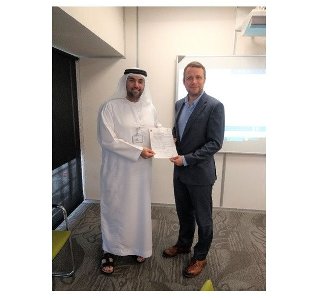 Hamad Rashid Al Belushi (Director of ATM, GCAA) & Alexis James Brooker (COO, Snowflake Software) during formal acceptance ceremony