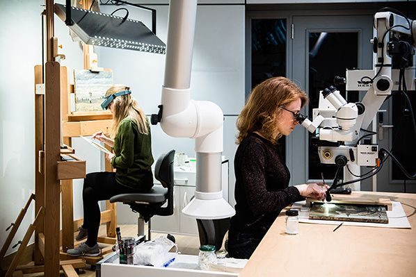 Restorers Saskia van Oudheusden and Kathrin Pilz at work. Photograph: ©Maartje Strijbis