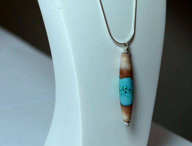 Pendentif Sable turquoise cylindrique