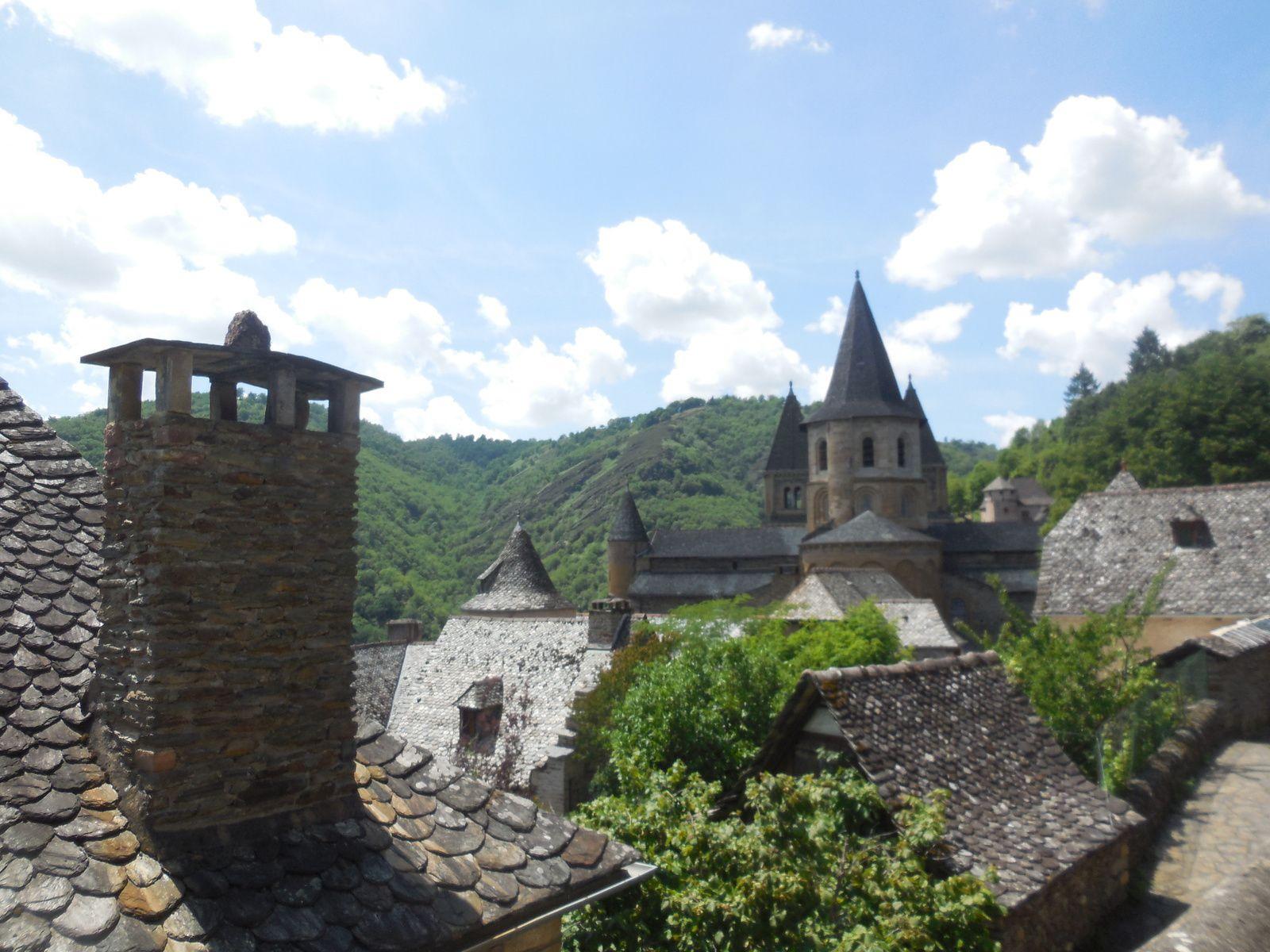 Toitures en lauze et façades en pierre à bâtir (schiste)...