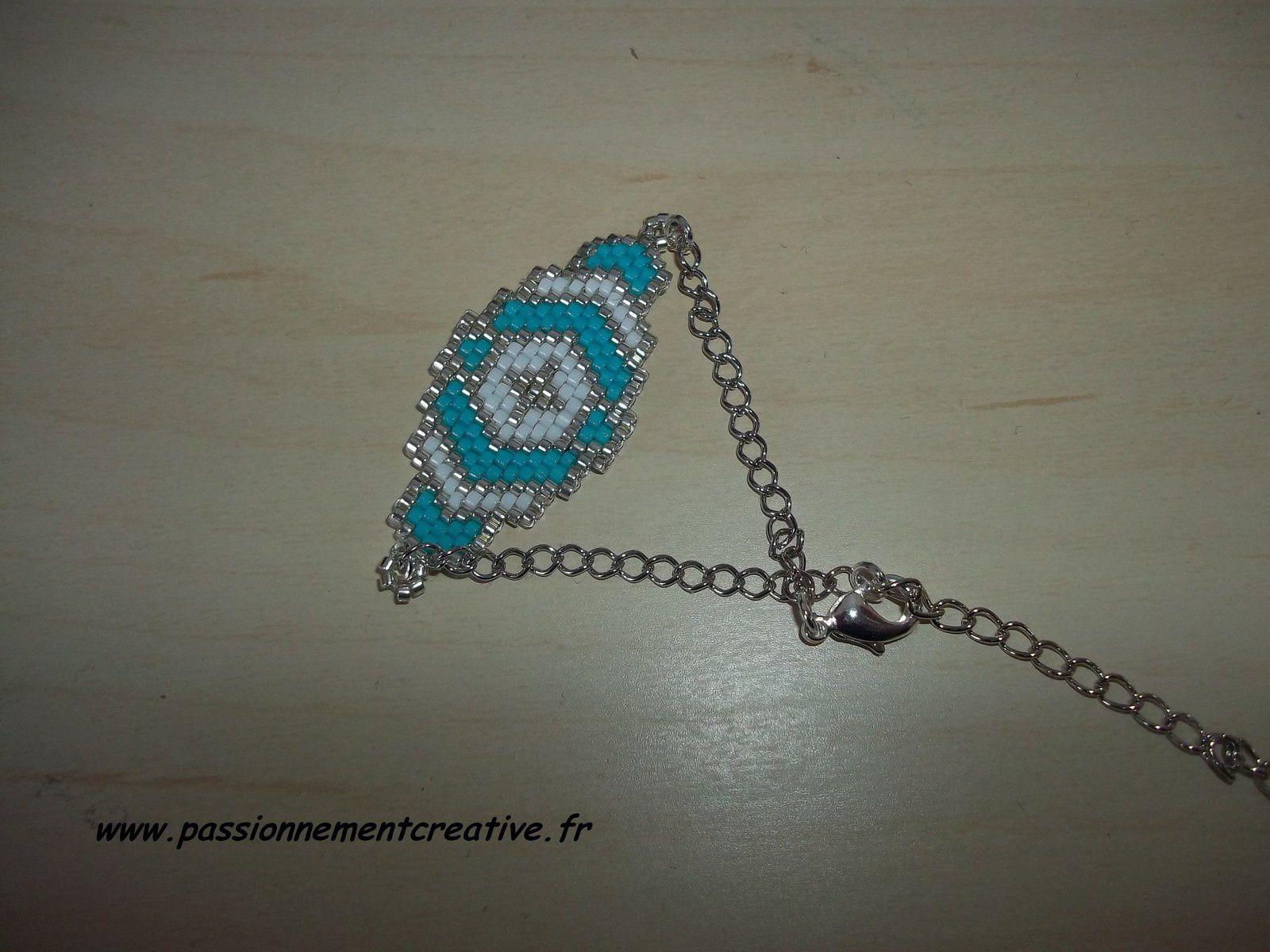 Bracelet en perles miyuki Croix argentée