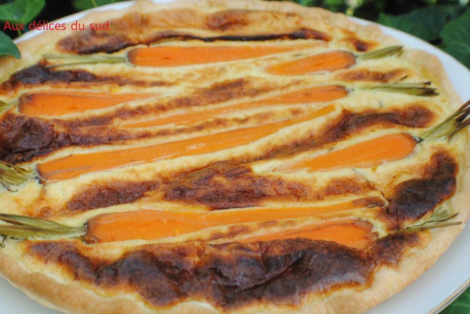 Tarte aux carottes et au chèvre frais .