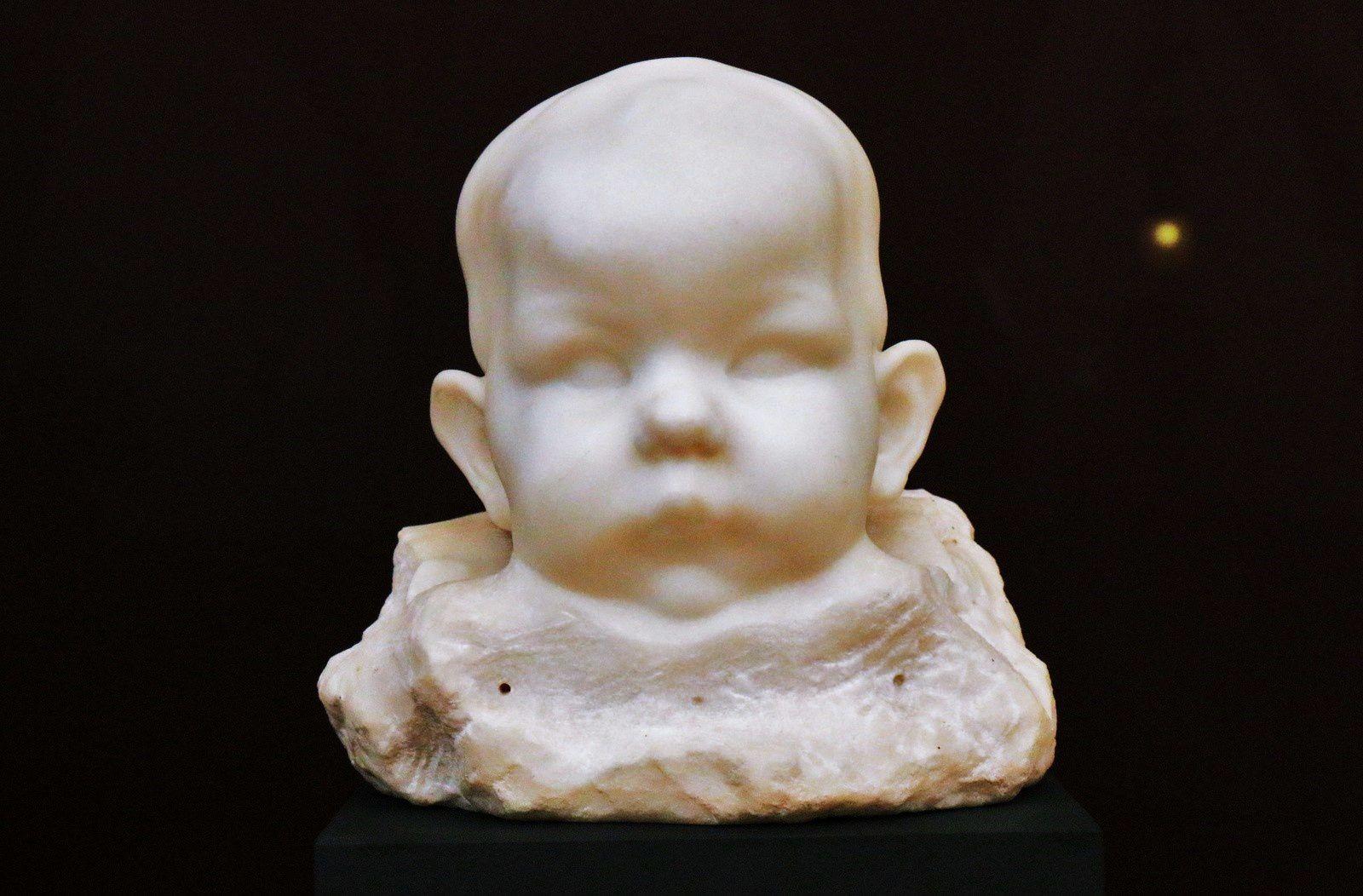 Lucien Schnegg, tête d'enfant