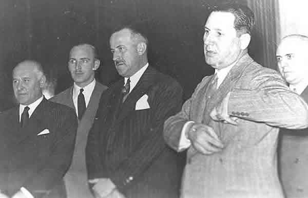 Nazi exile network principal Rodolfo Freude (2nd from left) and President Perón (2nd from right), who appointed Freude Director of the Argentine Intelligence Secretariat