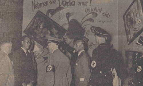 Adolf Hitler and other Nazi officials at the Dada wall of the Degenerate Art exhibition, July 16, 1937