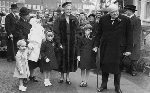 Winston and Clementine Churchill attend the christening of their grandchild Charlotte in 1954