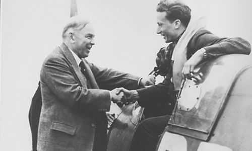 Bill Ash, returning from a 1941 dogfight, with the prime minister of Canada, Mackenzie King