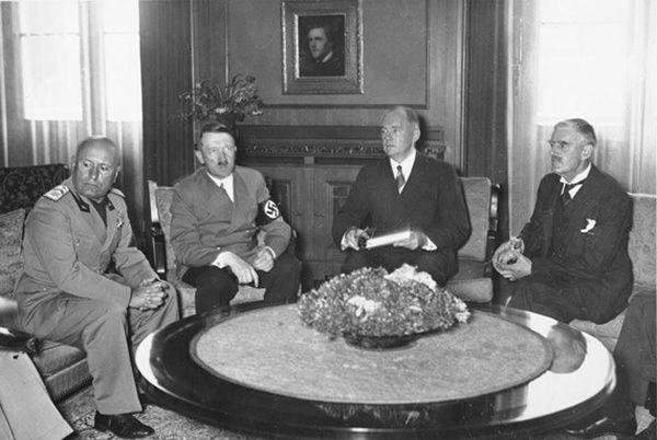 From left to right, Italy's Benito Mussolini, Germany's Adolf Hitler, translator Paul-Otto Schmidt, and Britain's Neville Chamberlain at the Munich Conference, in 1938
