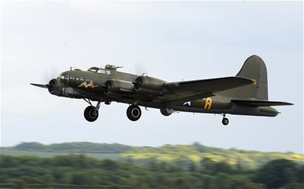 A Boeing B-17 Flying Fortress flies over Duxford