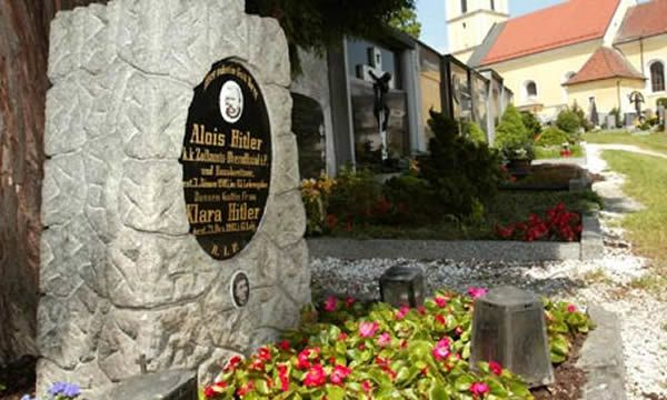 File - This undated file photo shows the grave of Alois and Klara Hitler, the parents of German Nazi Dictator Adolf Hitler, in Leonding near Linz, Austria. Leonding Mayor Walter Brunner says Friday, March 30, 2012, that the tombstone marking the grave will be removed. Brunner says the decision was made by a relative of the family who says she does not want the grave to continue serving as a neo-Nazi pilgrimage site