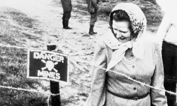 Prime Minister Margaret Thatcher examines a minefield during a postwar visit to the Falkland Islands