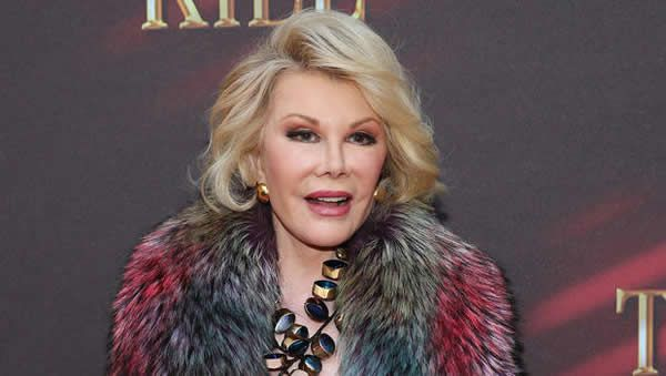 """Joan Rivers """"moved out of intensive care,"""" being """"kept comfortable"""""""
