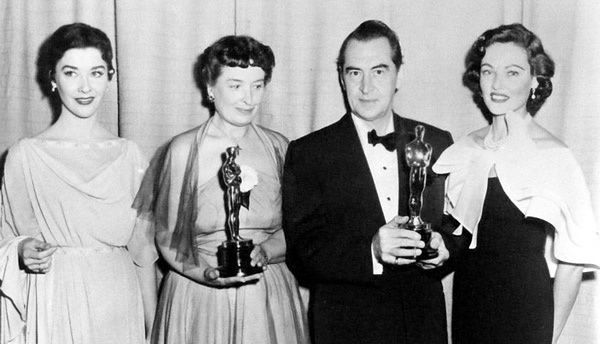 Emile Santiago and Charles Le Maire, winners of the Costume Design award for The Robe, are flanked by Virginia Leith (wearing a gown from the film) and presenter Gene Tierney