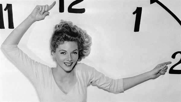 Barbara Lawrence is seen in a promotion for daylight savings time from 1956.