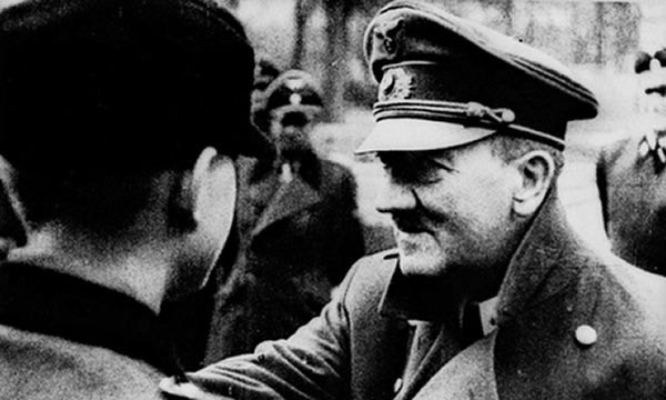 Adolf Hitler decorates members of the Hitler Youth in a photograph reportedly taken in front of the Chancellory Bunker four days before he died