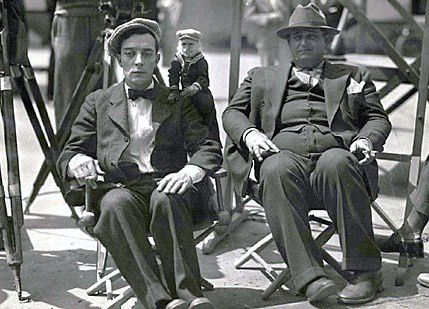 """Buster Keaton (L) and Edward Sedgwick (R) on the set of """"The Cameraman"""" 1928"""