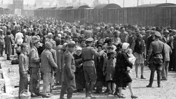 Hungarian Jews on the Judenrampe (Jewish ramp) after disembarking from the transport trains at Auschwitz-Birkenau, May 1944. To be sent rechts! – to the right – meant the person had been chosen as a laborer; links! – to the left – meant death in the gas chambers.