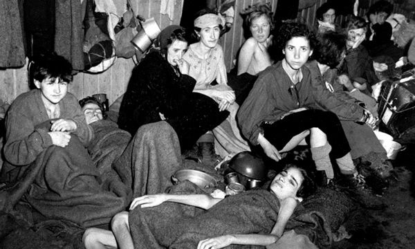 Women and children inmates at Bergen-Belsen camp, Germany, April 1945. Photograph